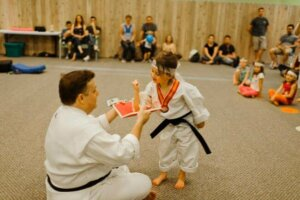 Breaking boards at a Eugene School of Karate birthday party